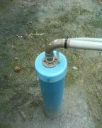 Бурение скважин. Установка насоса и наружная обработка скважины.