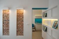 Цена ремонта двухкомнатной квартиры. Ниши из гипсокартона и специальное освещение - отличное решение в функциональной организации пространства.