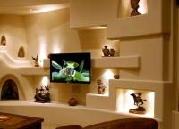 Eвроремонт отделка. Сложная отделка стены, в которой используются изготовление ниш и полок, иногда может заменить мебель.