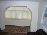 Расчет ремонта квартиры. Чтобы увеличить пространство в гостиной, можно расширить дверной проем на балкон и сделать художественную арку.