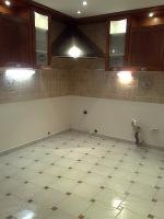 Ремонт 2х комнатной квартиры цена. Сложная укладка плитки на пол в кухне.