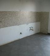 Ремонт квартир цены. Отделка стен кухни плиткой-мозаикой.