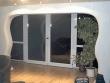 Ремонт квартир фото. Межкомнатные раздвижные двери в арке.