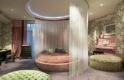 Ремонт квартир. Спальня в пастельных тонах с круглой мебелью создает удивительный уют.