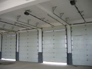 Установка автоматических ворот. Секционные автоматические ворота устанавливают в гаражных комплексах.