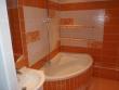 Ванная под ключ, фото. Установка угловой ванной и отделка плиткой навесных полок.