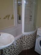 Ванная под ключ, фото. Отделка экрана ванной плиткой по дизайну заказчика.